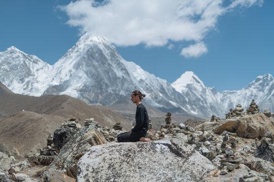 Man Doing Yoga In Himalayan Mountain
