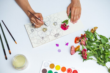 Overhead View Of An Artist Drawing Flowers