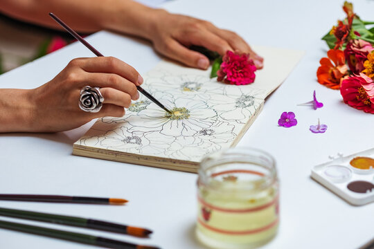 Anonymous Female Artist Painting With Watercolors Flowers On Sketch Pad