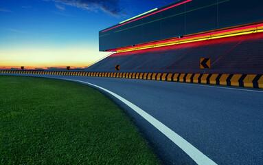 Evening view of empty asphalt racing track