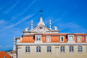 Lisbon, Rossio Square fountain and colorful historic buildings of historic city center