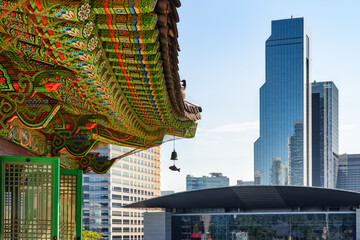 Colorful roof of Bongeunsa Temple and skyscrapers in Seoul
