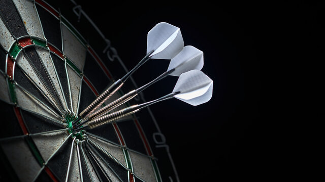 3 darts in the center of the dartboard