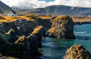 Fabulous view on Impressive Icelandic seascape. Majestic view on famous Arnarstapi village of sunny day. Saefellsnes peninsula. Amazing nature of Iceland. popular travel and hiking destination place