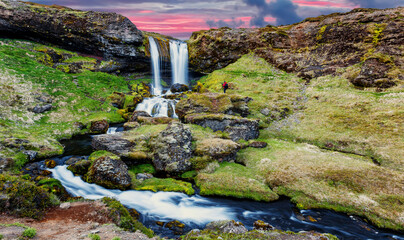 Incredible Nature landscape of Iceland. Fantastic picturesque sunset over  waterfalls. Iceland Is one famous natural landmark and travel destination place. Iconic location for landscape photographers