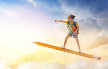 Fototapeta child flying on a pencil