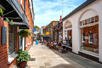 Perrin's Court, in Hampstead area, north London, England. Lively street with people sitting at cafés and doing shopping.