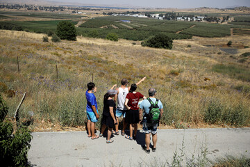 Israeli tourists visit a look-out point in the Israeli-controlled Golan Heights near the Israel-Syria frontier