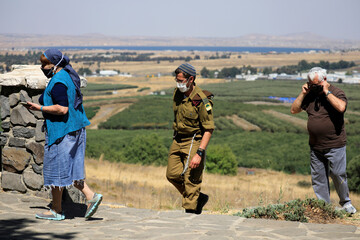 Israelis visit a look-out point in the Israeli-controlled Golan Heights near the Israel-Syria frontier