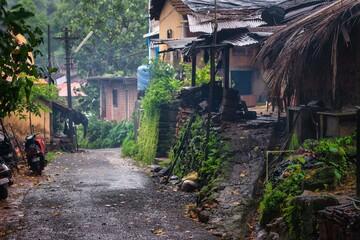 .12.07.2020 Arambol. Goa. India. wet goan village street in the rainy season with moss everywhere