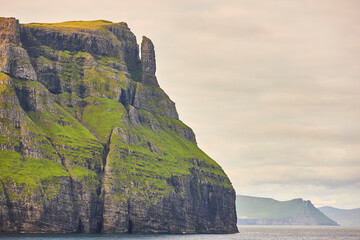 Picturesque green cliffs landscape and atlantic ocean. Faroe islands. Sudoroy