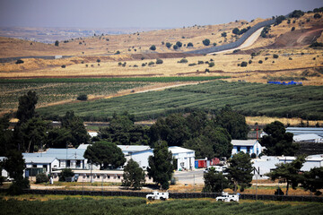 U.N. vehicles drive near Israel-Syria frontier seen from Israeli-controlled Golan Heights