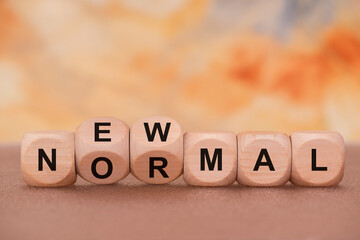 normal and new written on wooden cube