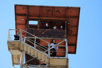 Israelis climb a deserted military watch tower as they tour the area of the Israeli-controlled Golan Heights near the Israel-Syria frontier