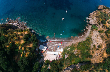Aerial view of Laurito little cliff beach, Positano - popular tourist destination in Italy. Sunny...
