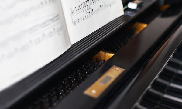 Unfolded music book on the grand piano is waiting to be played music lessons learn to read music school composer musical instrument musical culture classical music pianist piano grand piano