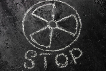 symbol of nuclear weapons and radiation on a black background and the inscription stop. concept refuse