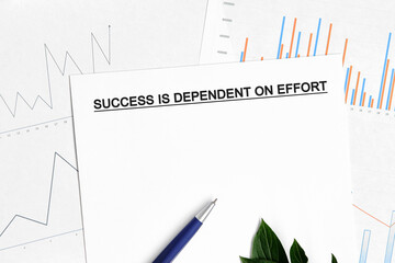 Success is dependent on effort document with graphs, diagrams and blue pen