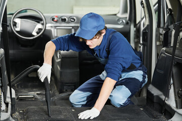 automobile detailing. Car carpet cleaning with vacuum cleaner