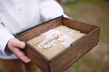 Wedding rings in a wooden box. Engagement ring