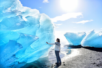 Iceland Amazing landscape at Iceberg beach. Tourist by icebergs on Ice beach, Breidamerkursandur...