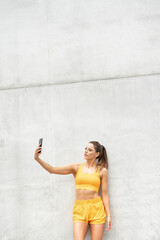 Fitness woman outdoors using mobile phone