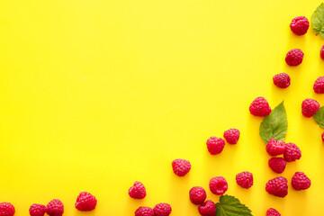 Tasty ripe raspberries on color background
