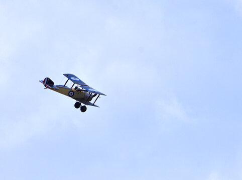 Vintage 1916 Sopwith Pup Aircraft in flight .