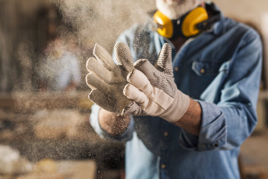Close up of dusty work gloves