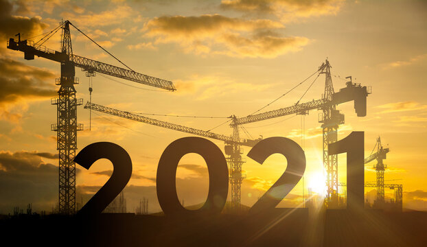 Silhouette construction site,Cranes building construction 2021 year sign