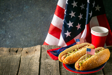 USA national holiday Labor Day, Memorial Day, Flag Day, 4th of July - hot dogs with ketchup and mustard on wood background, copy space