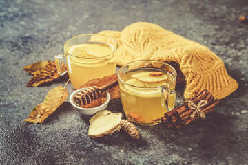 Fall immune system booster - ginger and turmeric tea and ingredients, rustic wood background