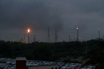 Excess natural gas is burnt, or flared, from Mexican state-owned Pemex's Tula oil refinery, located adjacent to the Tula power plant belonging to national power company Comision Federal de Electricidad, or CFE, in Tula de Allende