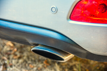 Right exhaust chromed pipe of a mondern SUV