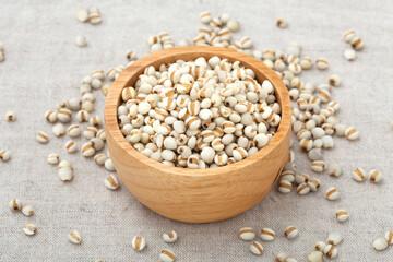 Pearl barley in wooden bowl