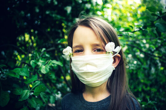 Portrait Of Girl Wearing Mask And Flowers