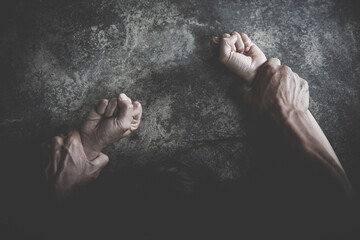 Fototapeta Man's hand holding a woman hand for rape and sexual abuse concept, Wound domestic violence rape, concept photo of sexual assault, International Women's Day obraz