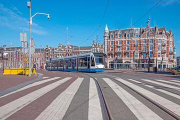 Driving tram in the city center from Amsterdam in the Netherlands