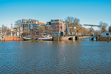 City scenic from Amsterdam at the river Amstel in the Netherlands