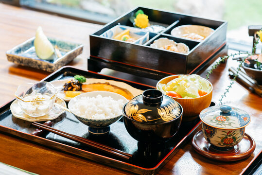 Ryokan series: Breakfast set of Japanese and American style on wooden table in ryokan, traditional Japanese hotel