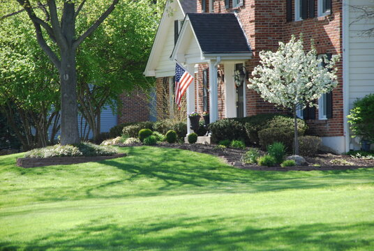 Suburban Home with American Flag