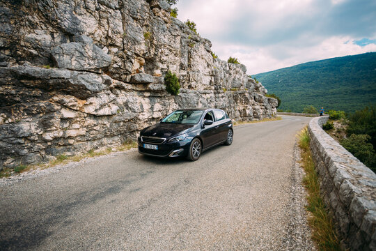 Black colour Peugeot 308 car on background of French mountain nature landscape the Gorges Du Verdon in France