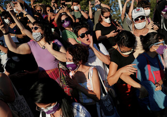 Demonstrators shout slogans during a protest against femicide and domestic violence, in Istanbul