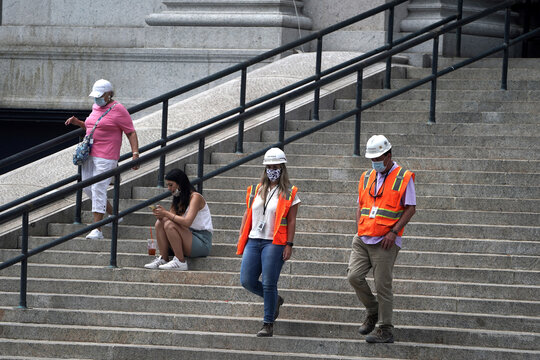 Workers stand on the steps of the U.S. Postal Service Farley building that Facebook announced it would lease for office space