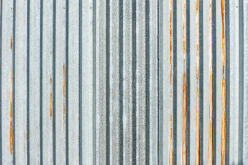 Old gray metallic vertical material wall background.