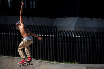 A skateboarder skates in Astoria Park in Queens, New York
