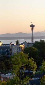 View of the Olympic Mountain Range in Washington State from Capitol Hill district in Seattle, Washington. The view of the mountain range, Puget Sound, and Space Needle is in the early evening hours.