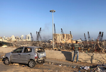 A man stands near the site of Tuesday's blast in Beirut's port area