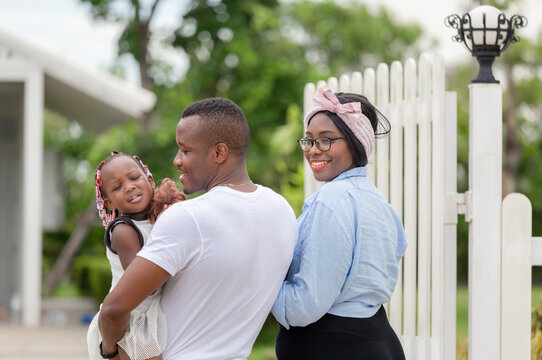 Cheerful african american family in front of their new house, Happiness family concepts