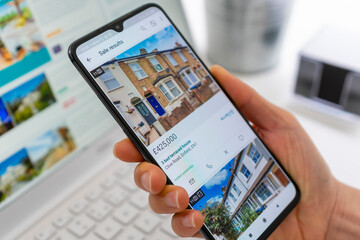 Melbourne, Australia - Jul 27, 2020: Browsing properties for sale in UK